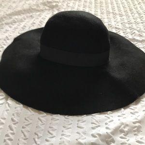 Large black floppy wool hat